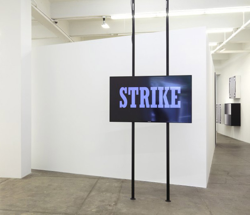Strike, 2010. Single channel high-definition digital video, sound, flat screen mounted on two free standing poles. Courtesy of Hito Steyerl, Esther Schipper Gallery (Berlin), and Andrew Kreps Gallery (New York).